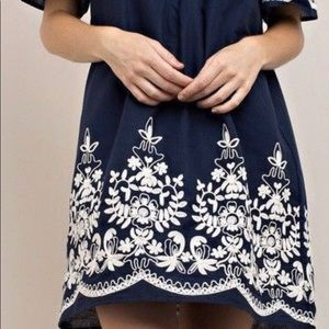 Beautiful blue and embroidered white dress